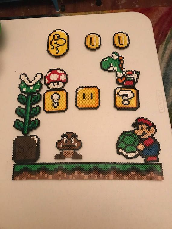 Complete set of super Mario magnets! They fit on every fridge and would be a great gift