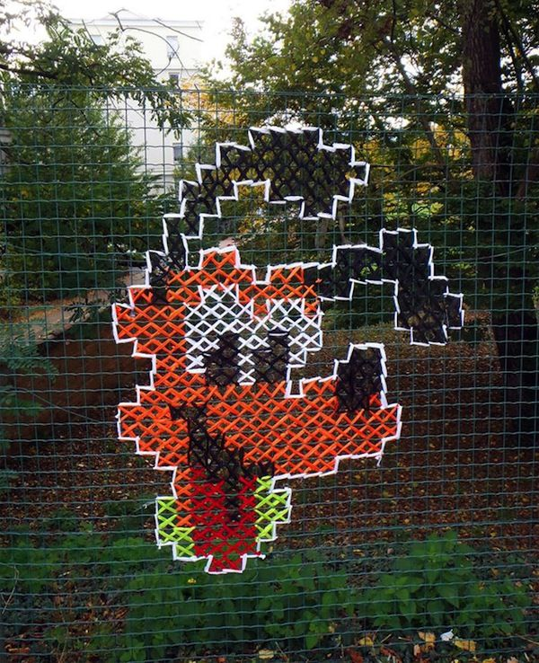 Creative Street Art 'Murals' That Have Been Stitched Onto Fences - DesignTAXI.com