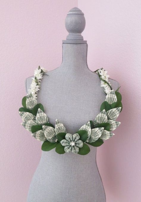 Beautiful money lei made with money flower and money leaves. Perfect for graduations, weddings, and more!