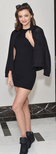 Who made  Miranda Kerr's black sneakers and jacket?