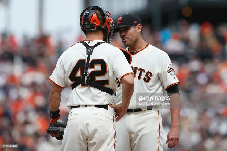 Starting pitcher Matt Moore #45 of the San Francisco Giants talks to catcher Nick Hundley #5 of the San Francisco Giants in the sixth inning against the Colorado Rockies at AT&T Park on April 15, 2017 in San Francisco, California. All players are wearing #42 in honor of Jackie Robinson Day.