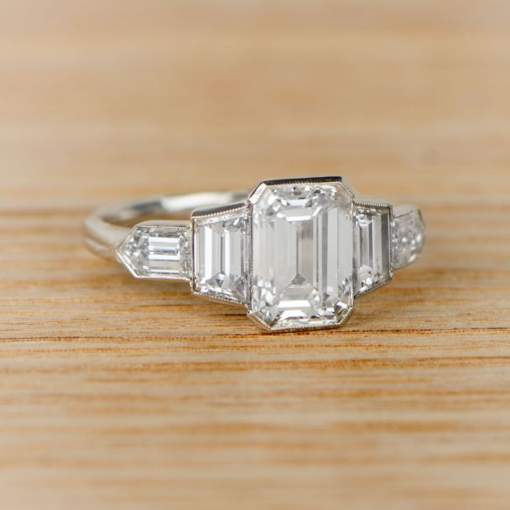A STUNNIG new addition to our vintage engagement rings collection. A beautiful Estate Emerald Cut Engagement Ring.