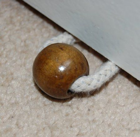 Bead to keep draught excluder on the door.
