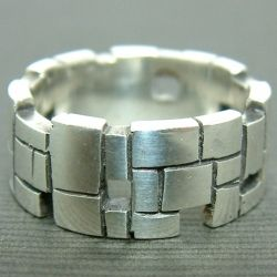 This ring was first sculpted in wax and then cast in sterling silver.