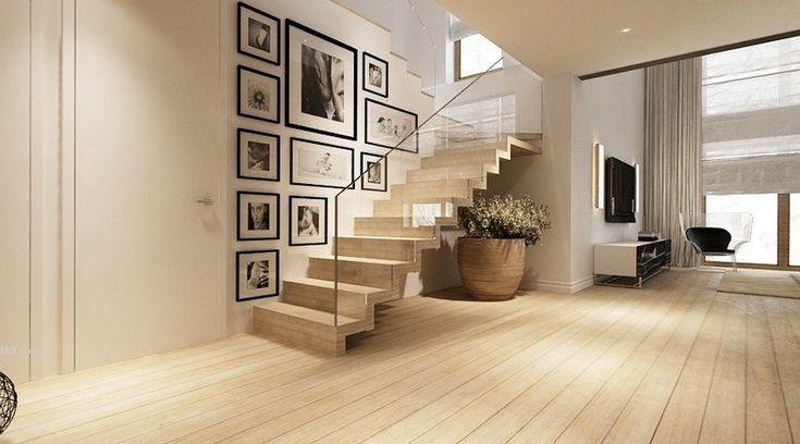 Wood Staircase With Glass Balustrade And Large Indoor Vase Above Parquet Flooring In Cozy Living Room