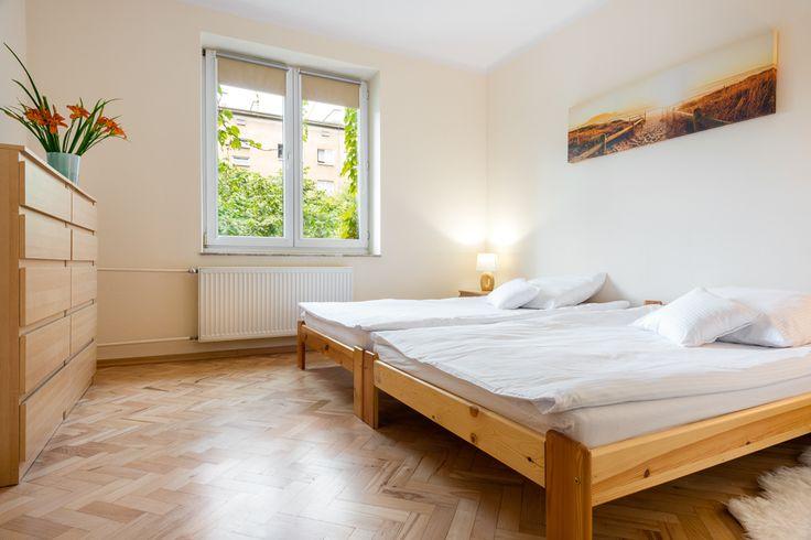 Cracoff   Chocimska 24 beige wood neutral bedroom with 100% light-blocking roller blinds