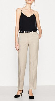 Size information:  In size 10 (can vary according to size): -Inside leg length approx. 80 cm  -Hem opening approx. 41 cm  Details:  -Elegantly shimmering, finely textured satin gives these trousers in comfortable stretch cotton their modern chic! -The elaborately finished waistband with a high-quality lining and concealed hook fastener is strikingly accentuated by a narrow faux leather belt with a contrast colour reverse side and metal eyelets. -Smart pressed pleats accentuate the look and…