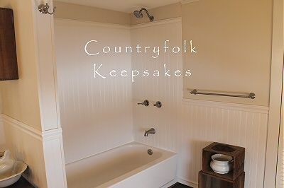 Spruce up your bathroom by adding vinyl beadboard  instead of a plain tub/shower surround. :> )