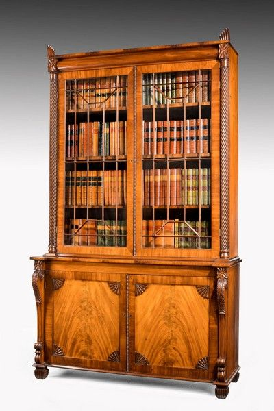 Regency period mahogany bookcase with matching flared panels to the bottom doors