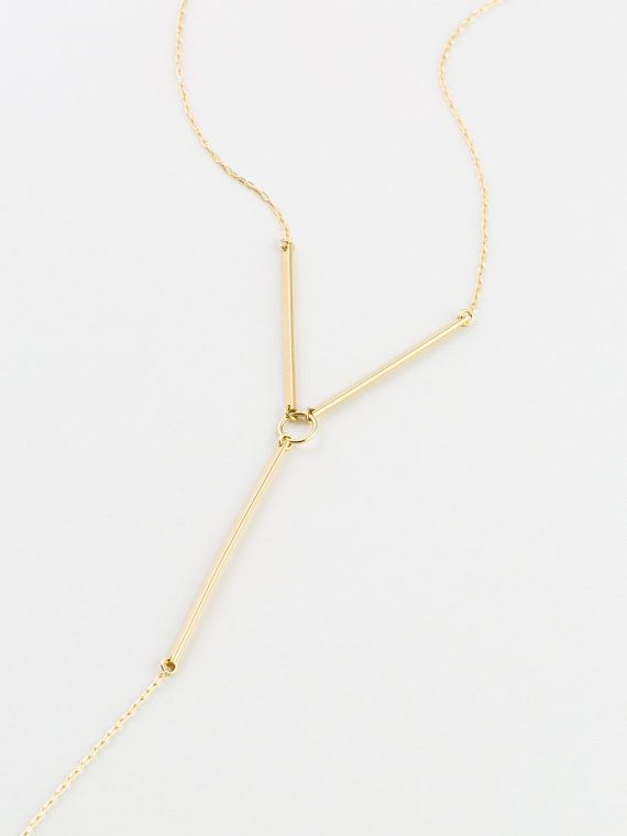 A Bold Y Necklace in 14k Gold Fill, Sterling Silver, or 14k Rose Gold Fill. Hand forged bars surround a center ring, with a simple chain drop. A badass style thats right on point.  - Hand-formed components, assembled with love. - All raw materials are top quality, and sourced in the USA. - 100% 14k Gold Filled, Sterling Silver, or 14k Rose Gold Fill.   …………………………………. HARNESS THE POWER ∙ LN152_Y  - Pretty much the coolest Y necklace, for super cool ladies only. - Top bars are ~1.5 each - The…