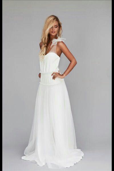 Vestido de novia sencillo. Yo le pondría el tul de plumeti