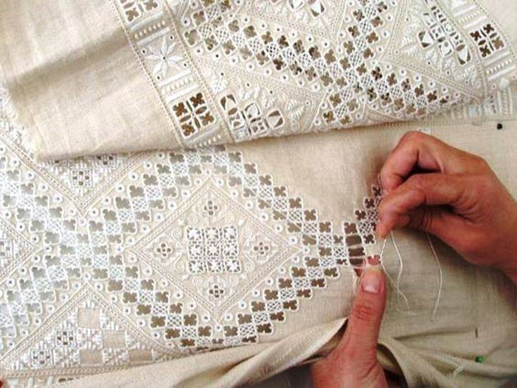 At first glance - to many of us - this looks like Hardanger embroidery, but it's not. It's Lefkara lace. Lefkara lace was named for the Greek island which is famous for producing this kind of whitework and drawn thread embroidery.  Check out this video on the island of Lefkara and its lace at https://www.youtube.com/watch/?v=Nuo1j_-doJQ