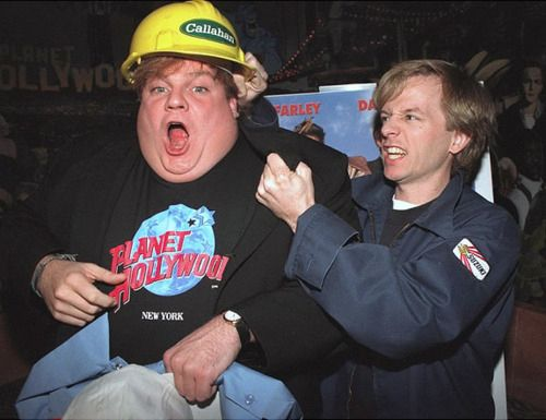 David Spade fake fighting with Chris Farley at Planet Hollywood: | 48 Pictures That Perfectly Capture The '90s