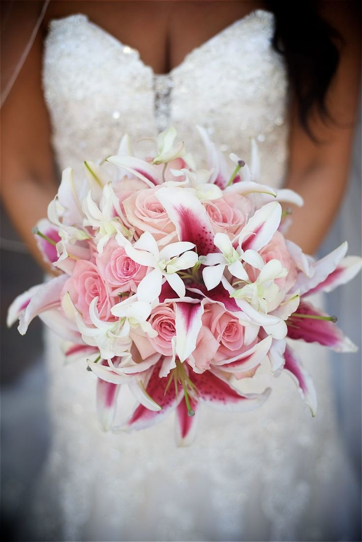 #fuchsia pink beach wedding #pink stargazer bouquet #destination wedding…