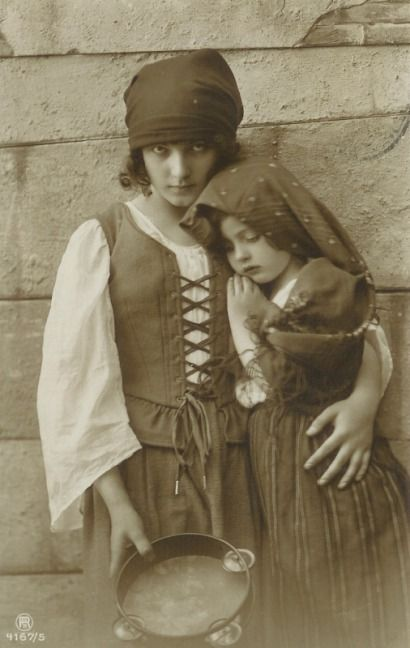 gypsy children in traditional dress posed for a postcard