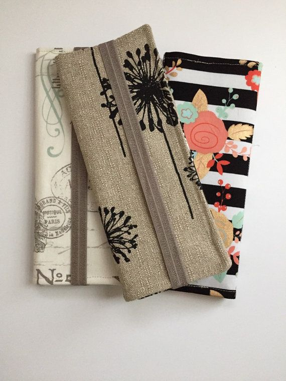 Tract Holder, tri-fold. Fits many tracts in each section. Keeps your tracts neat and organized and in a pretty holder. This holder is made of tan and black Premier Prints Dandelion fabric, with a coordinating fabric for the interior pockets. it is lined with a stiff interfacing. It also includes a business card pocket and an elastic strap for closure. Please note: Made to order, fabric placement may vary from picture. Dimensions approximately 4 inches wide and 10 inches tall when closed…