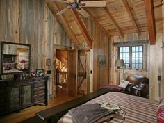 The second floor bedrooms are paneled vertically in Blue pine to showcase the vaulted ceilings.