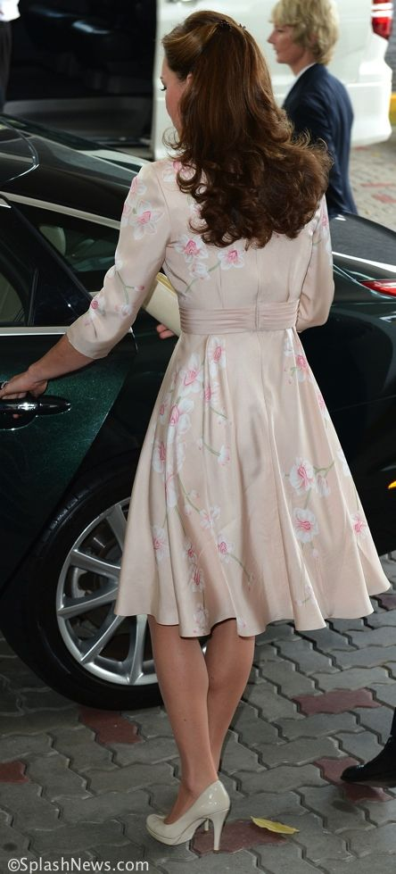 Kate selected a British designer for the launch of the Jubilee Tour in Singapore, wearing a pale pink Jenny Packham dress. Here we see the Duke and Duchess being greeted upon arrival at the airport.