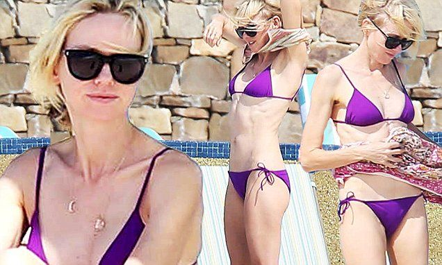 Naomi Watts shows off her stunning figure in a purple two piece