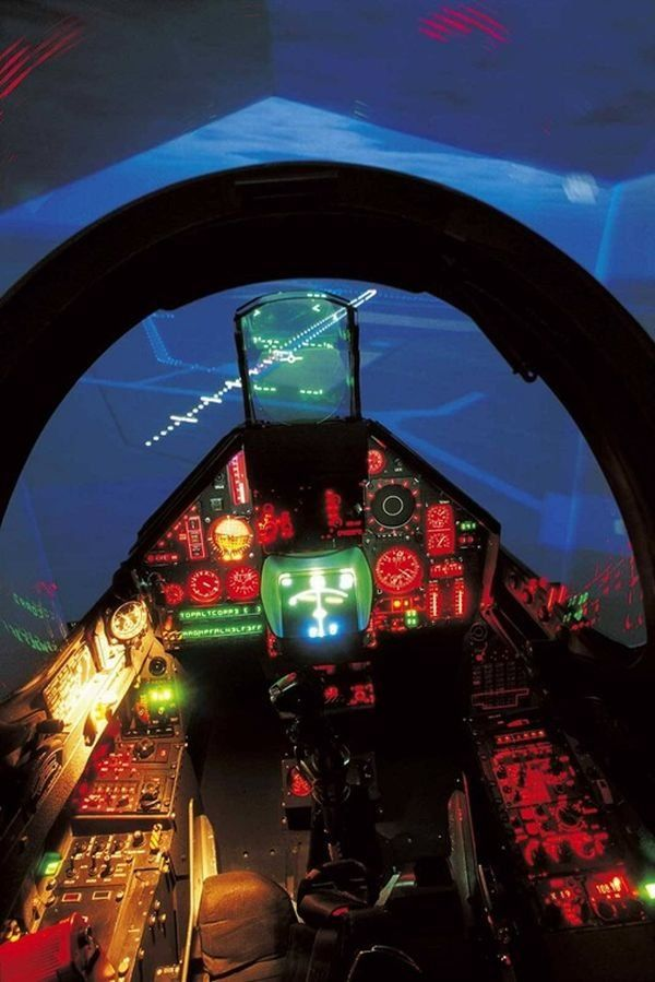 MILITARY JET NIGHTTIME COCKPIT INSTRUMENT PANEL - AIRFIELD ALL LIT UP