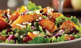 Carmelized Peach Salad - field greens, spinach, warm peaches, red onions, toasted pecans, and gorgonzola in white balsamic vinaigrette