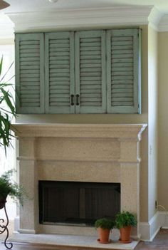 Shutter door tv cabinet mediterranean media storage. Can extend the drywall to do a recessed cabinet                                                                                                                                                      More
