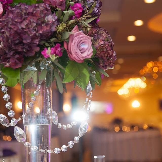 Purple Wedding Centerpiece with a little bling!  Narcissus Florals, Toms River, NJ...  www.mynarcissus.com