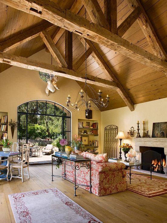 Living Room vaulted ceiling exposed beams paned