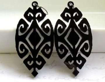 Laser cut Ethnic geometric earrings hang from NICKEL FREE Gunmetal plated over brass earwires.Total Length is approx 2.7 inches (69mm) from the top of the ear wire.These earrings make a bold statement..