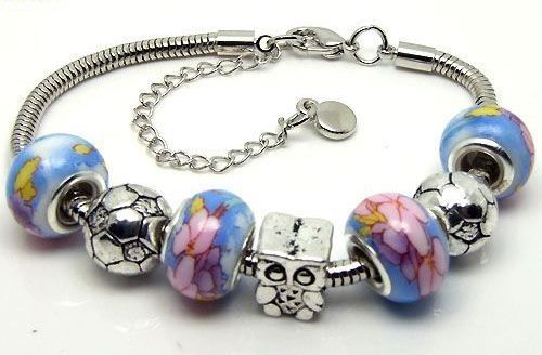 SC119 Handmade silver charm bracelet, on snake chain, with soccer ball charms and flower porcelain European beads. Normally retails for around $25 each - my selling price (including postage within Australia) is $15.00 each... Please feel free to contact me if your require price for postage overseas…