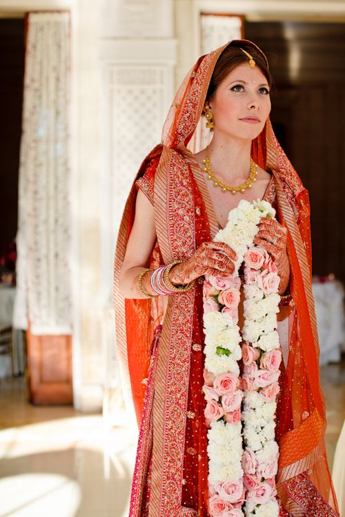 Stunning bride at her exuberant Hindu wedding - photos by Cathy and David Photographers | junebugweddings.com