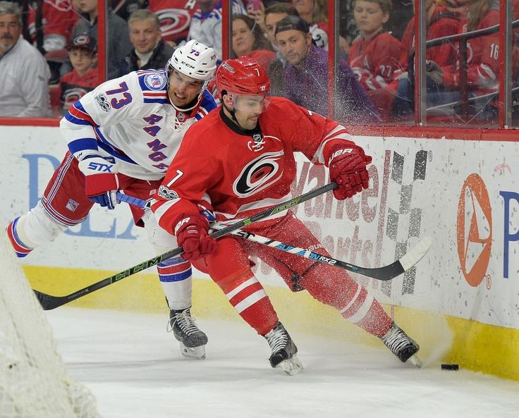 Rangers vs. Hurricanes:  March 9, 2017  -  The Rangers fell to the Carolina Hurricanes, 4-3, on Thursday at PNC Arena:     Brandon Pirri #73 of the New York Rangers battles Ryan Murphy #7 of the Carolina Hurricanes for a loose puck along the boards during the game at PNC Arena on March 9, 2017 in Raleigh, North Carolina.