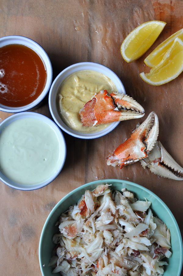 Fresh cracked Dungeness crab with a trio of dipping sauces.