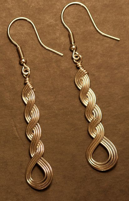 "Sterling Silver (argentium) earrings made using ""Wirely"" wire weaving technique when multiple wires are woven together and kept together with tension."