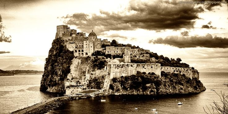 Castello Aragonese, jutting off the Italian island of Ischia...it has a beautiful view of Ischia at sunset <3