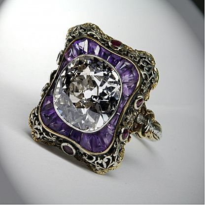 Victorian era 5.36 carat old cushion-cut diamond with amethyst border. I LOVE THIS!