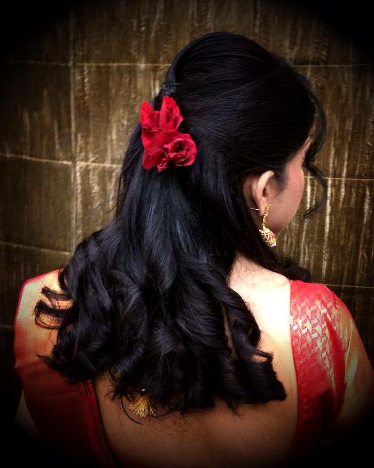 Indian bride's bridal reception hairstyle. Hairstyle by Swank Studio.