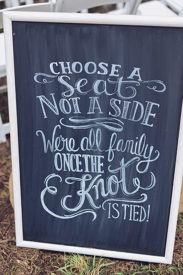 chalkboard choose a seat wedding sign