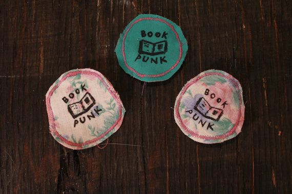 BOOK PUNK Badges made from recycled materials. size: 6 cm diameter    this item was made in a studio that is also home to a lil kitty cat.