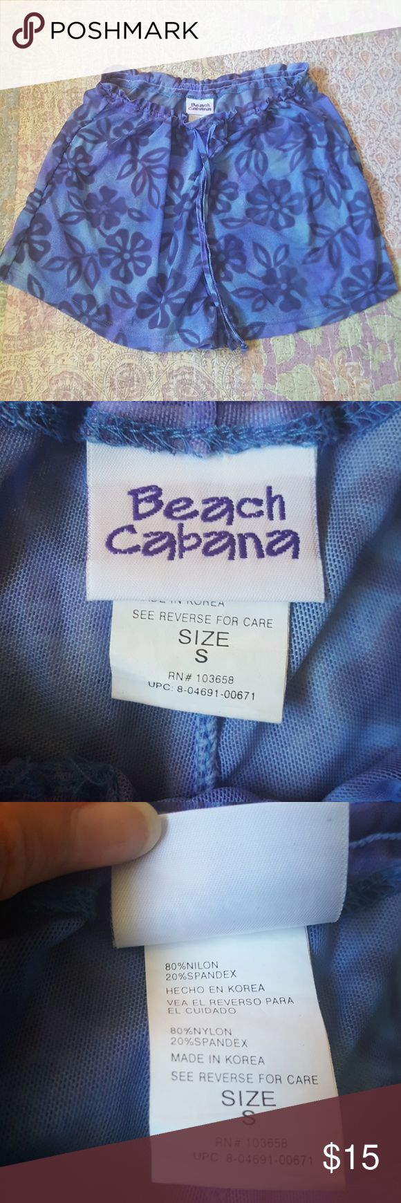 Cover-up Shorts Sheer for pool or beachwear. Drawstring closure. Could fit a medium, marked small!  Periwinkle blue with dark navy blue flowers. Great condition Modeling available upon request✌ Feel free to make an offer 💚 Beach Cabana Shorts