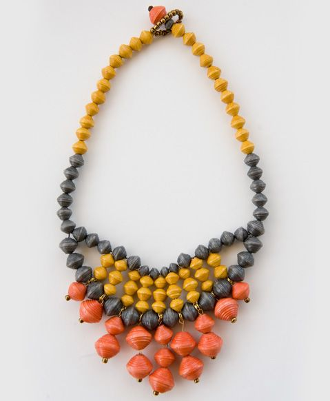 Sweet Clementine Bib, made in Uganda {with love} out of paper beads.  Noonday Collection uses fashion and design to offer sustainable income to the world's most vulnerable through dignified job creation.
