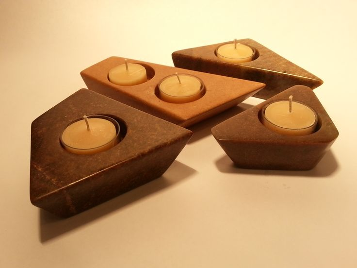 Hand carved stone tealight candle holders.  Beautiful art pieces for your formal home decor.  www.artinstones.com