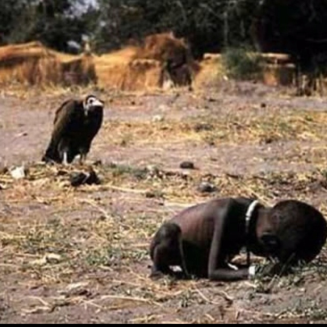 """The photo is the """"Pulitzer Prize"""" winning photo taken in 1994 during the Sudan Famine. The picture depicts stricken child crawling towards an United Nations food camp, located a kilometer away. The vulture is waiting for the child to die so that it can eat him. This picture shocked the whole world. No one knows what happened to the child, including the photographer Kevin Carter who left the place as soon as the photograph was taken. Three months later he committed suicide due to depression."""