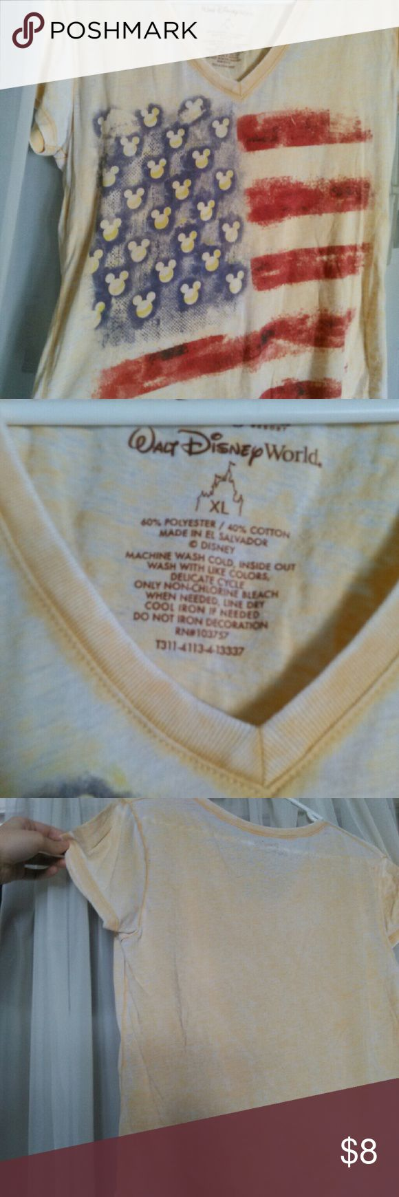 Disney american flag v neck Disney american flag v neck shirt. Distressed yellow with red and blue flag. Size  xl Disney Tops Tees - Short Sleeve