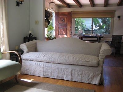 linen slipcover on camelback sofa furnishings and decor pinterest linens upholstery and seat cushions