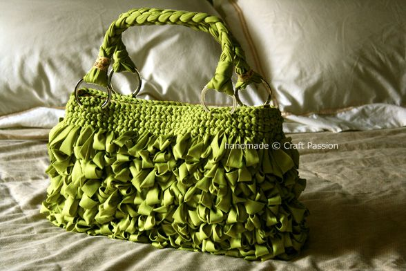 Crochet directions for a cool loopy purse made out of Tshirt yarn.