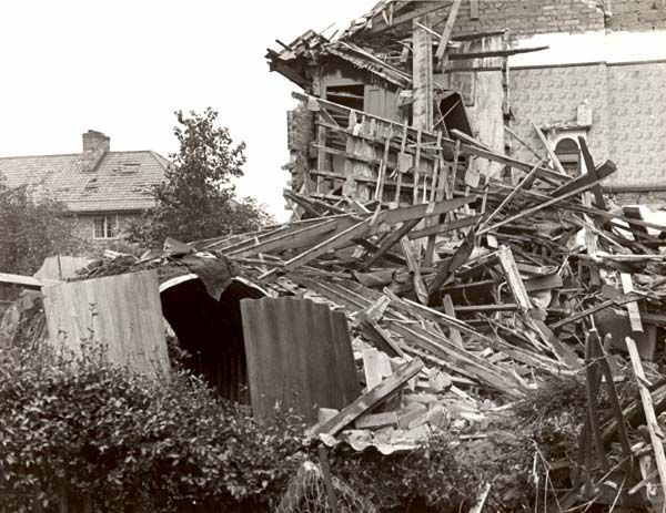 The authorities sought to publicise instances where people had survived in Anderson shelters even though close to bomb explosions. Anderson shelters consisted of thin skinned corrugated iron and were only effective if half buried in the ground and covered in a mound of earth, making them inherently cold and damp - but the shape was very strong.