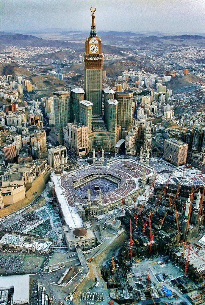 ☪ The Kaaba or Ka'aba is a cuboid building at the center of Islam's most sacred mosque, Al-Masjid al-Haram, in Mecca, Saudi Arabia. It is the most sacred site in Islam. Wherever they are in the world, Muslims are expected to face the Kaaba – i.e. when outside Mecca, to face toward Mecca – when performing salat (prayer). From any point in the world, the direction facing the Kaaba is