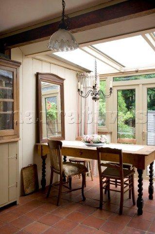 Candelabra Hangs Above Dining Table In Devon Kitchen Conservatory