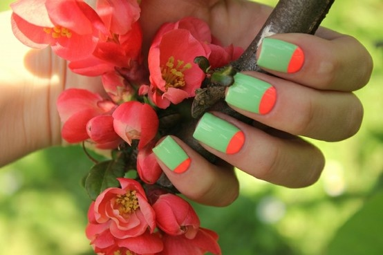Neon half moons- DIY: Paint nails color of choice and let dry. Press paper hole reinforcers on the base of nails, close to cuticle. Paint over entire nail and peel off reinforcers before polish dries. Finish with top coat.